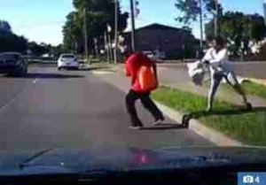 Horror: Lady Tries to Kill Her Own Boyfriend, Pushes Him in Front of Moving Car (Video)